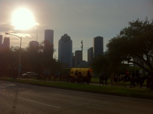 Riders get set to begin the parade as the sun rises over downtown Houston.