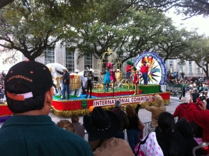A float rides past Houston City Hall.