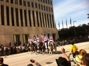 Riders with flags that have flown over Texas throughout its history.