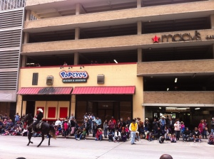 Spectators watch from the garage of the soon-to-be-closed downtown Macy's store.