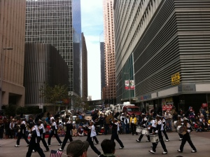 A high school marching band makes its way down the parade route.