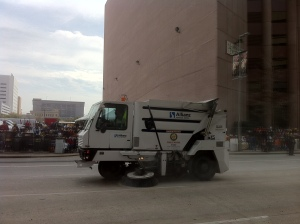 A street-sweeper makes some necessary adjustments.