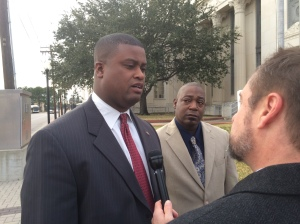 Derrick Newman, right, listens as his attorney, Langston Adams, talks to reporters following the verdict in Newman's civil rights violations lawsuit trial.