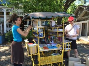 Artists Jon Hofer and John Pluecker set up their book bike.
