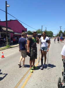 A woman on crutches manages to make her way down Westheimer.
